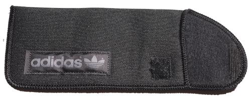 An open Adidas sunglass pouch