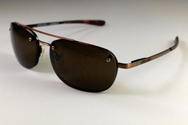 Copper-framed sunglasses with dark brown lens
